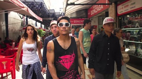 Santos/SP/Brazil - May - 2016: group of young diverse friends hanging out looking confident in urban city gen z concept in slowmotion