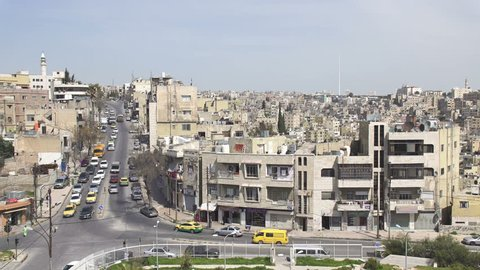 Panoramic view of old town Amman, Jordan. Car traffic, sunny spring day.
