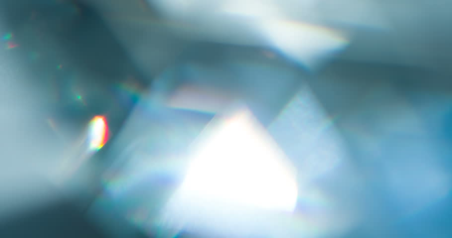 Sparkling Diamond Highlights. Loop. The light passes through the facets of a slowly rotating diamond and creates repetitive sparkling highlights and rainbow colors | Shutterstock HD Video #1027887782