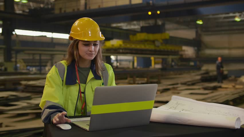 Female caucasian engineer working on laptop n manufacturing plant | Shutterstock HD Video #1027919672