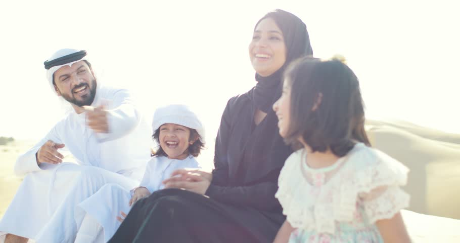 Happy muslim family spending weekend making safari in the dubai desert. Parents and kids having good time. lifestyle moments | Shutterstock HD Video #1027983692