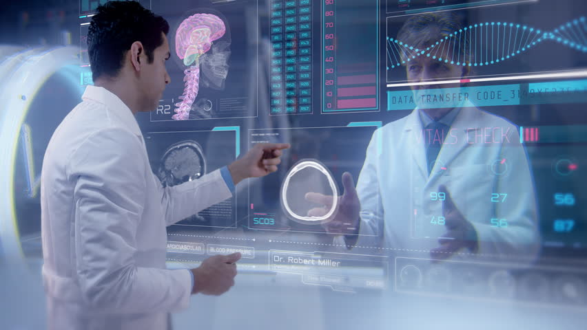 Two doctors having an online video conference analyze a patient's medical MRI diagnosis by checking on a large glass screen with futuristic holograms. Concept of: medicine, doctors, future, holography