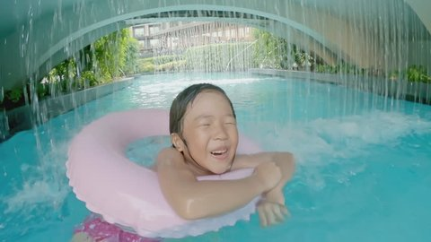 cute girl play with floating ring in the swimming pool