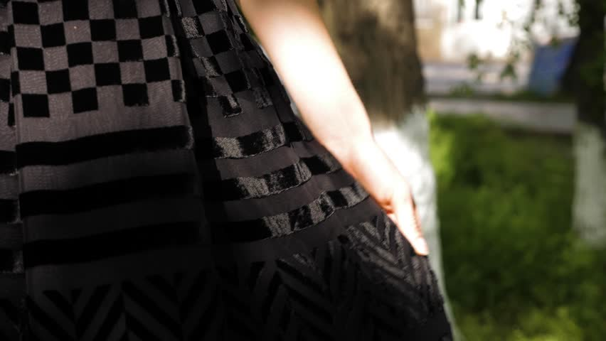 Macro model demonstrates dark brown flared skirt with velvet geometric ornament and black shirt with lacy elements | Shutterstock HD Video #1028136302