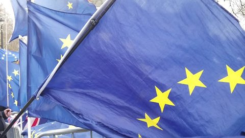 Flags of the European Union flying at a brexit march in London