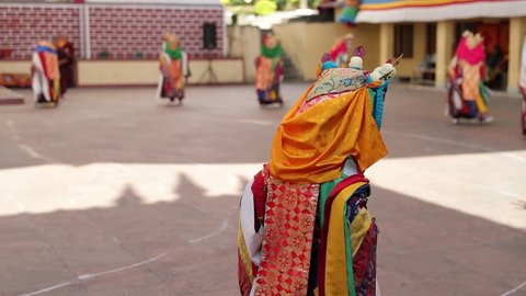 Tibetan dance in Buddhism temple at the ceremony in Tibetan colony at Indian Himachal Pradesh. Filmed in slow motion.