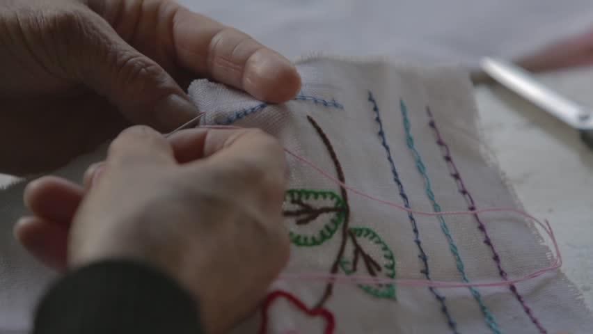 Old woman working making handmade knitting handmade work seam stitching   Shutterstock HD Video #1028343182