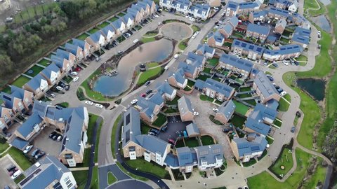 Aerial view of modern houses with an artificial pond in the middle in Greenhithe, Kent