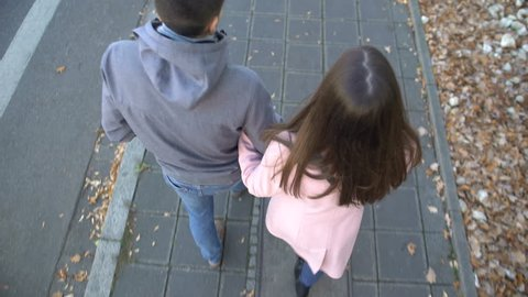 Young couple walking on street, woman blaming and pushing boyfriend, break up