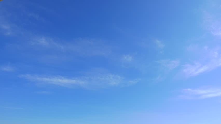 Time lapse of high cirrus cloudsing left in a blue sky. #1028441012
