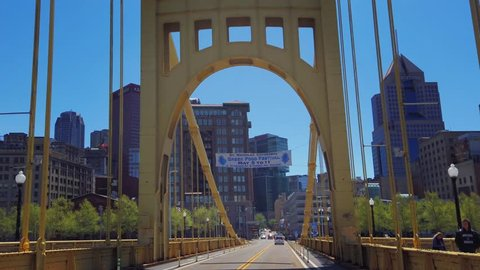 PITTSBURGH - Circa April, 2019 - A forward driving perspective on the 6th Street Roberto Clemente Bridge over the Allegheny River in Pittsburgh, Pennsylvania.