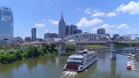 Nashville, TN / April 5, 2016: Ferry Heading Up Nashville River, Cityscape & Skyline Behind by Aerial Drone, Tour Boat Vacation Tourism