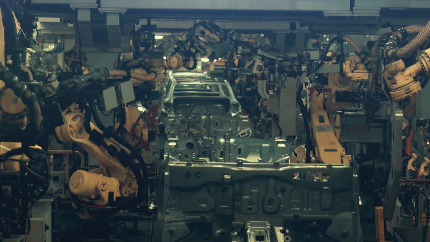 Welding robots movement in a car factory | Shutterstock HD Video #1028589392