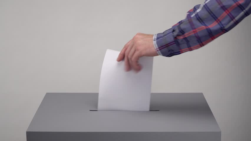 Gray ballot box. Presidential and parliamentary elections. The voter throws the ballot into the ballot box. | Shutterstock HD Video #1028594972