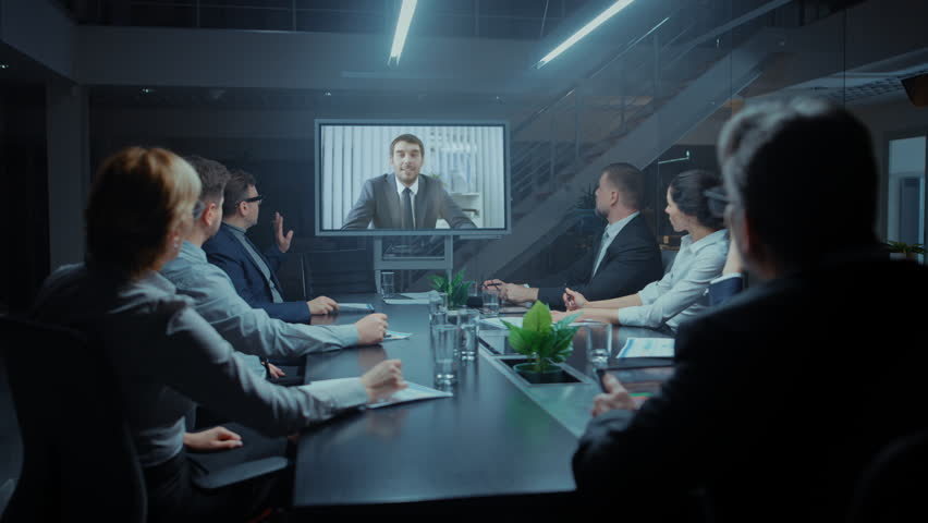 In the Conference Room Group of Directors, Investors and Businessmen Making Late Night Video Conference Call To Talk with International Corporation Representative