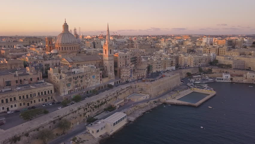 25P dawn flying towards iconic Carmelite church dome and steeple in Valletta Malta | Shutterstock HD Video #1028626682