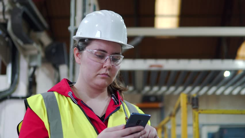 Mobile Phone Call Conversation With Female Industrial Worker In Factory. | Shutterstock HD Video #1028640332