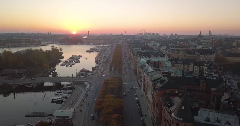 Beautiful aerial view, Stockholm Sweden. Majestic sunset. Drone flies forward over traffic. Magnificent skyline colours.   Shutterstock HD Video #1028697482