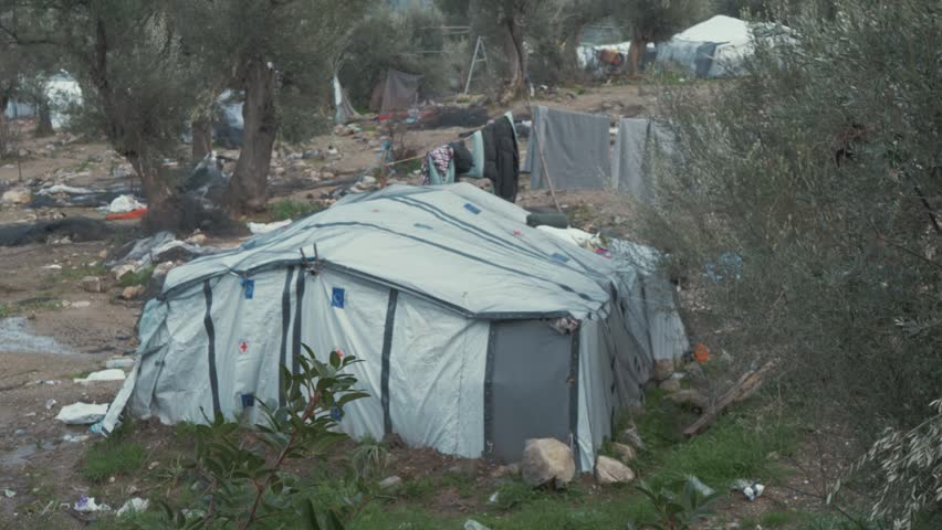 Establishing Shot of Tents and Clothes Lines at a Refugee Camp in Greece. | Shutterstock HD Video #1028777312