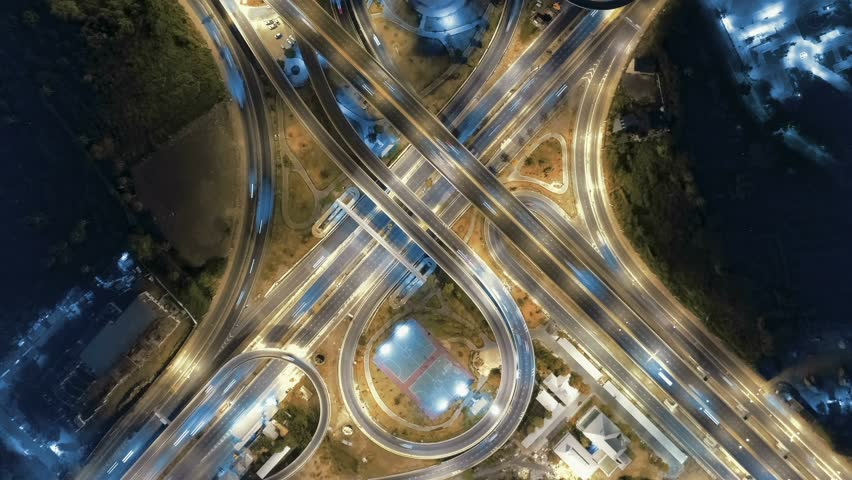 Hyperlapse timelapse of night city traffic on 4-way stop street intersection circle roundabout in bangkok at night, thailand. 4K UHD horizontal aerial view. | Shutterstock HD Video #1028800262