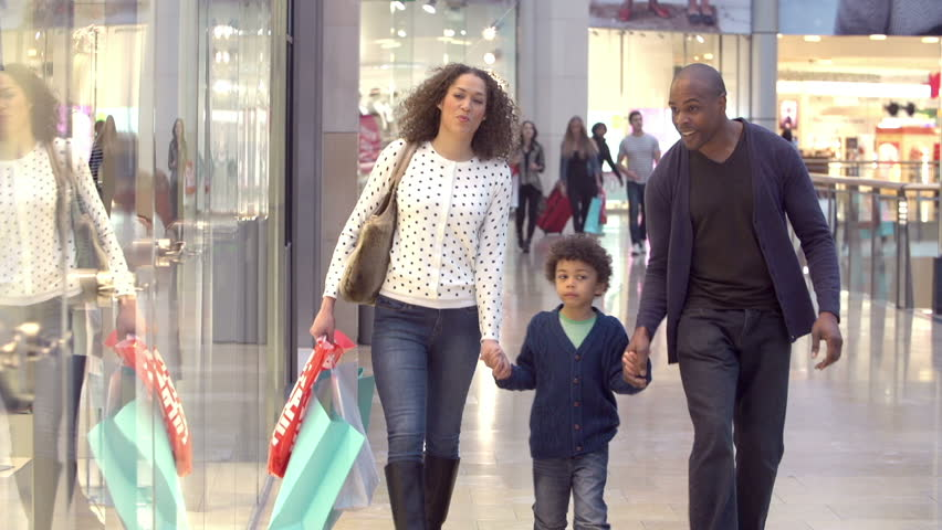 Family walking through shopping mall carrying sale bags looking at window displays.Shot on Sony FS700 at frame rate of 100fps | Shutterstock HD Video #10288262