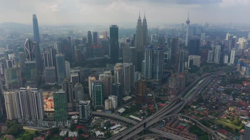 Sunny day flight over kuala lumpur city downtown traffic road jam aerial panorama 4k malaysia | Shutterstock HD Video #1028930462