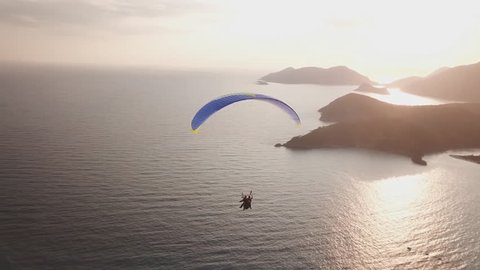 Beautiful aerial view of the soaring parachute at sunset over the Arab sea. Aquarium, in Mirbat, Oman.