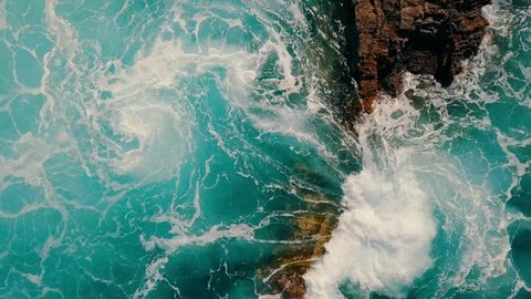 eye view on sea waves, island. Aerial shooting seascape coastline at sunny day.