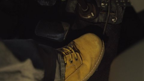 Big tan boot of male driving and abruptly switching from gas to brake pedal  close up 4k