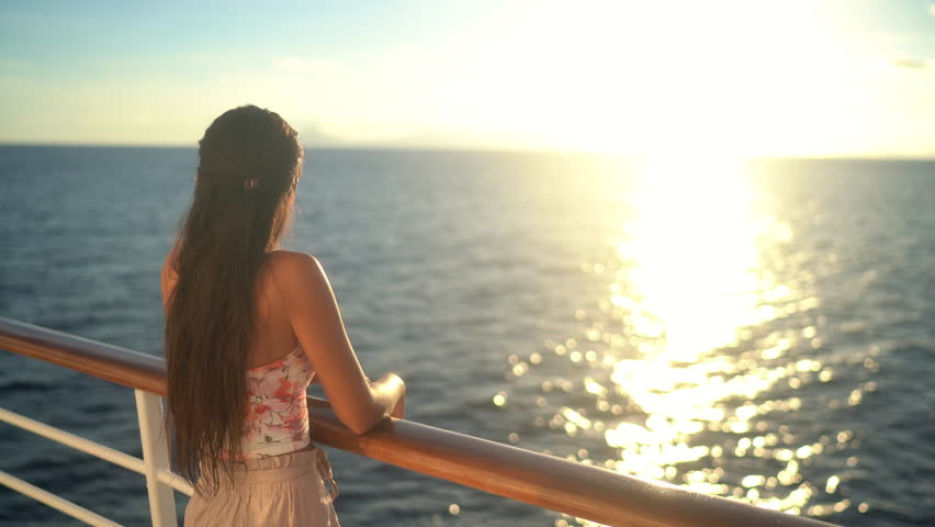 Cruise ship vacation travel woman enjoying sunset at sea on boat with beautiful sunset on travel at on the ocean | Shutterstock HD Video #1029264542