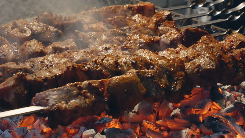 Cooking juicy meat on the grill. Steak, shish kebab. delicious Fried slices of pork or lamb. | Shutterstock HD Video #1029318542