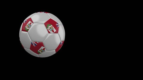 Soccer ball with the flag of Bermuda flies past the camera, slow motion, 4k footage with alpha channel