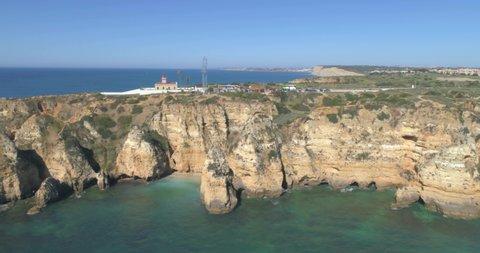 Aerial Scenic seascape, of Ponta da Piedade promontory (cliff formations along coastline of Lagos city), famous natural landmark destination, Algarve. South Portugal.