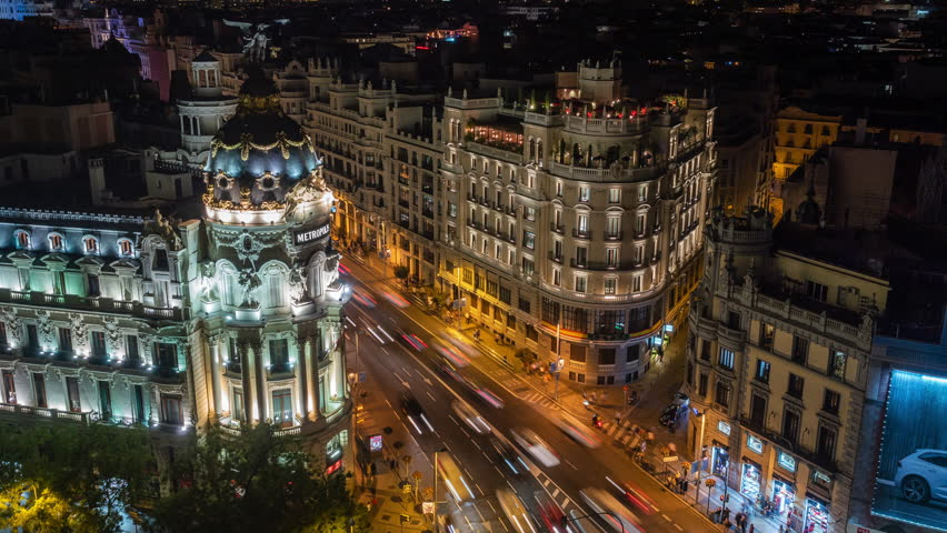Night time lapse view of architectural landmark Metropolis building and traffic on Gran Via street in central Madrid, Spain. | Shutterstock HD Video #1029384632