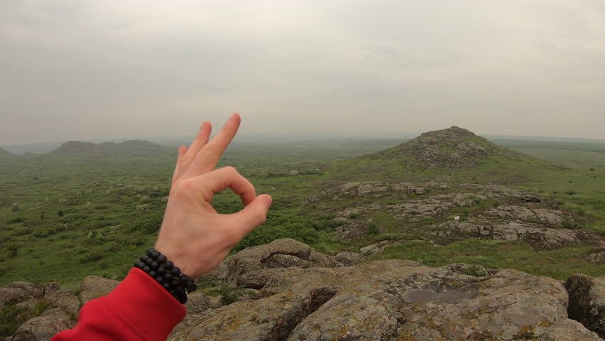 POV, hiker male red hand shows ok and thumbs up gesture   Shutterstock HD Video #1029389792