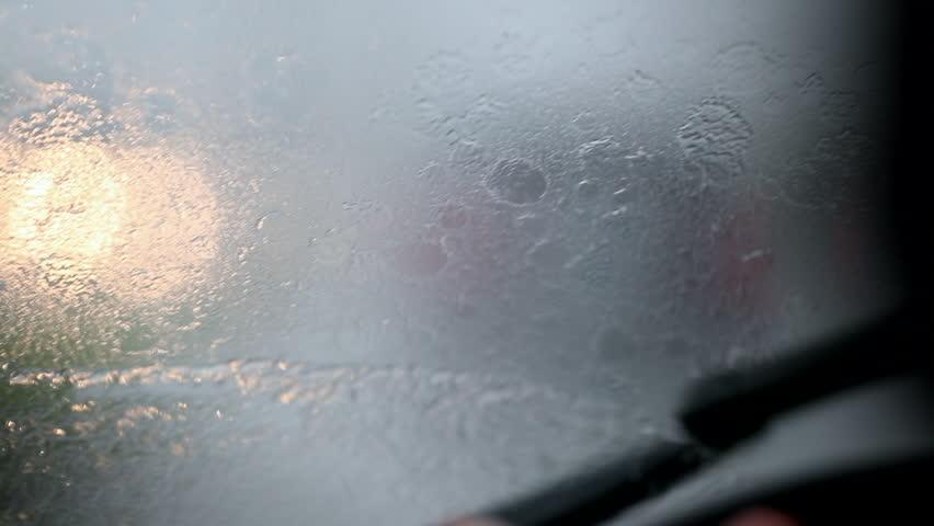 Windshield wipers in slow-motion clearing rain | Shutterstock HD Video #1029422372