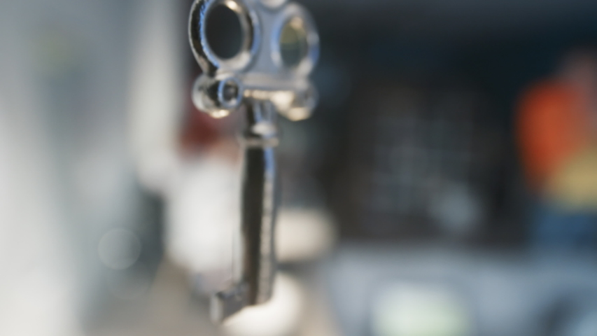 Close-up view of beauty decorative key. An iron key from the lock hanging on blurred background. #1029563252