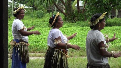 Tabuaeran, fanning island/kiribati - march 20, 2019: unidentified  indigenous people dance and sing at tabuaeran, fanning island, kiribati