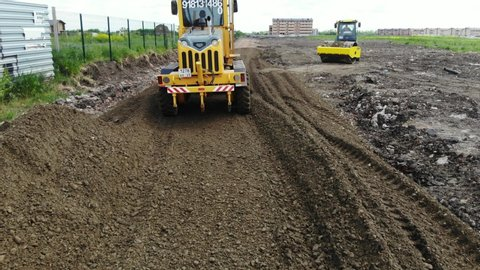 Special transport movement. The bulldozer leveled the ground. The work of the bulldozer. Work machinery. Construction of the road.