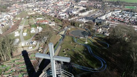 Aerial view of watch tower located at Valkenburg aan de Geul is a municipality situated in the southeastern Dutch province of Limburg also showing the camping ground and toboggan run 4k quality