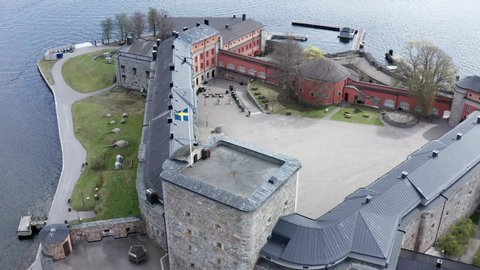 Aerial  4k shot of military Vaxholm Fortress with cannons an artillery. Stockholm Swedish archipelago
