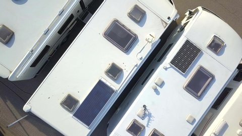 Aerial view of many camper vans on a parking lot.