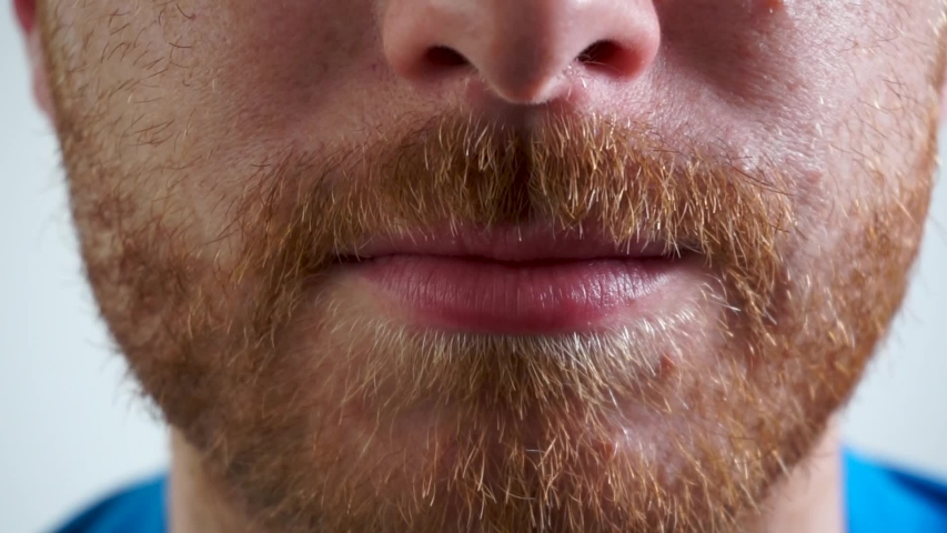 Super close up of a young caucasian ginger man smiling | Shutterstock HD Video #1029615812