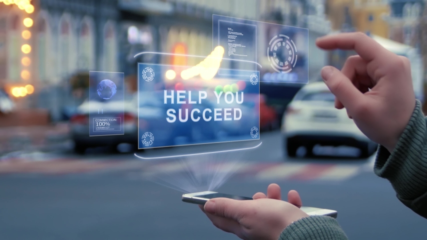 Female hands on the street interact with a HUD hologram with text Help you succeed. Woman uses the holographic technology of the future in the smartphone screen on the background of city | Shutterstock HD Video #1029622922