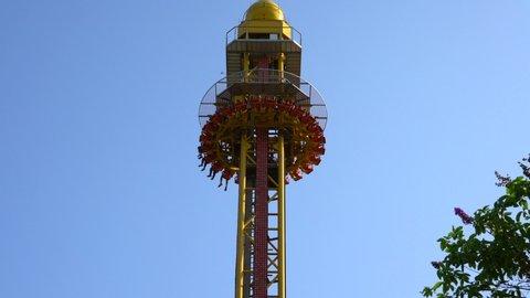 Drop Tower Ride Dropping at a Carnival