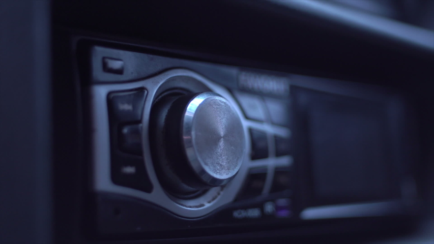 Man's Hand Tuning Radio In The Car   Shutterstock HD Video #1029682622