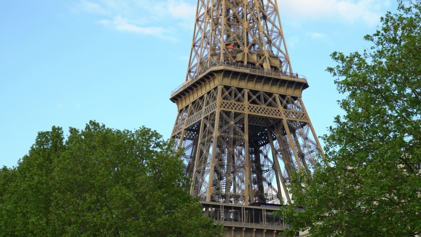 Close up view of the Eiffel Tower in Paris, France | Shutterstock HD Video #1029711812