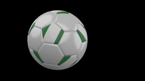 Soccer ball with flag Nigeria flies past camera, slow motion blur, 4k footage with alpha channel