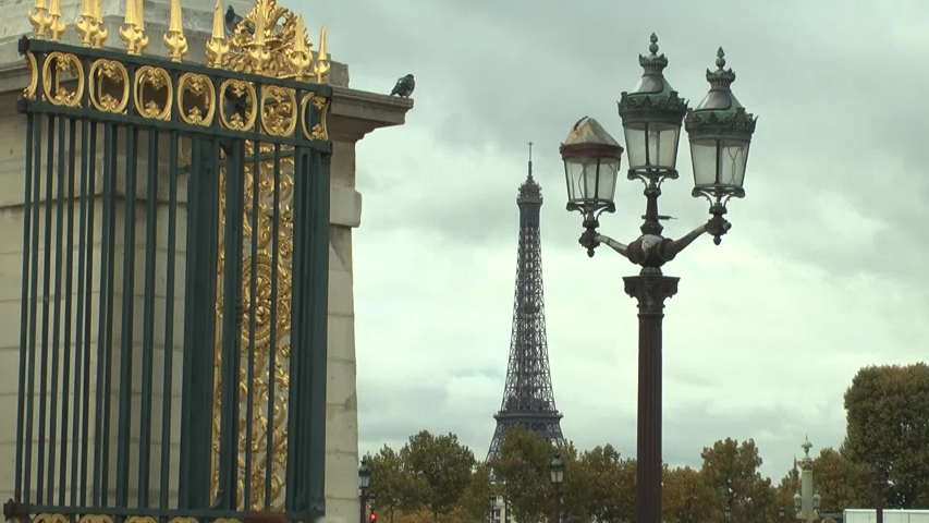 Tuileries Garden gate detail, street lamp and Eiffel Tower at background