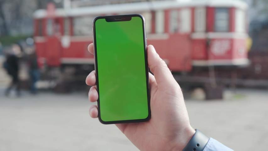 NEW YORK - April 5, 2018: Young man hands holding a smartphone with vertical green screen background touristic car city touchscreen wireless business evening cellphone communication device digital | Shutterstock HD Video #1029886442